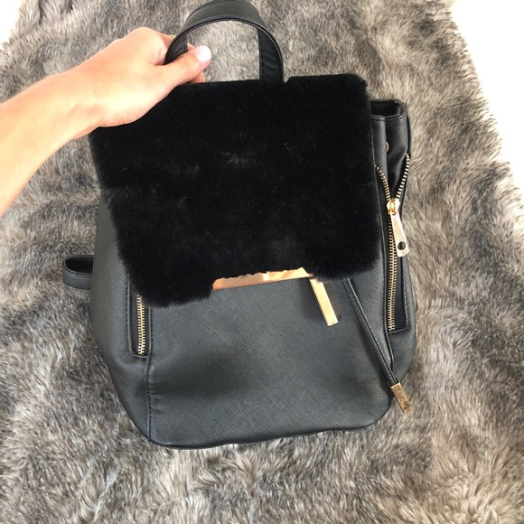 Windsor Handbags - Black leather and furry backpack